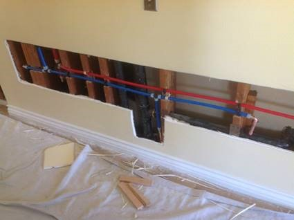 Hot and cold water supply lines being replaced throughout an Albuquerque home.